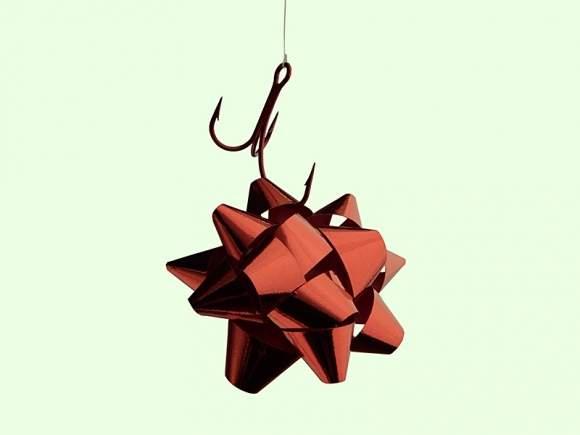 """Okres zbliżających się Świąt to znakomity czas dla phisherów, którzy będą chcieli złapać nas na """"haczyk"""" i dobrać się do naszych pieniędzy i danych."""